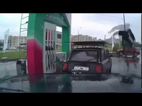 Russian Gas Station Attendant Break Dancing On A Car