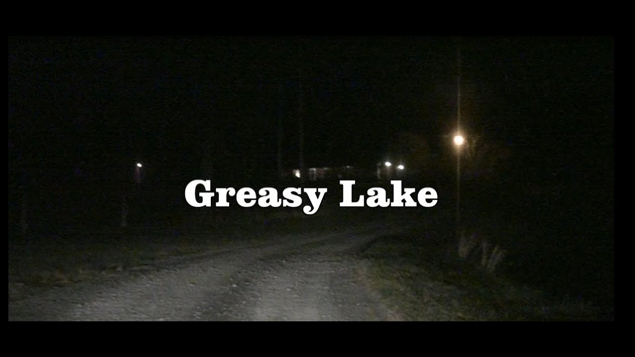 "a quest for the boys in greasy lake by t c boyle The ""greasy lake"" is a well versed short story written by tom coraghessan boyle which gives us an account of events that take place in one night in the lives of young men that lead to a revelatory moment for them."
