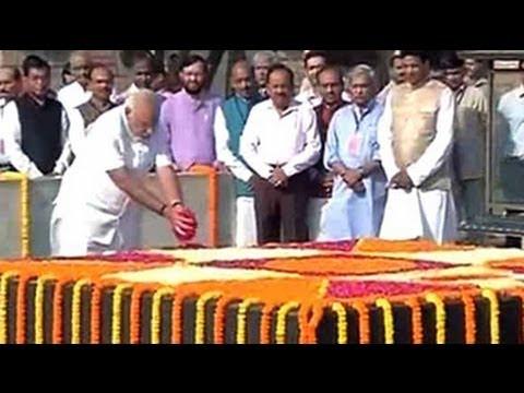 Narendra Modi visits Rajghat, pays homage to Mahatma Gandhi