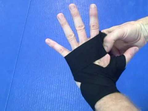 Hand wrapping Basics - How to wrap your hands for boxing, kickboxing, and Muay Thai with short wraps
