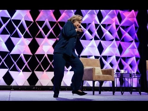 Woman throws a show at Hilary Clinton in LA at the Institute of Scrap Recycling Industries 4/10/14
