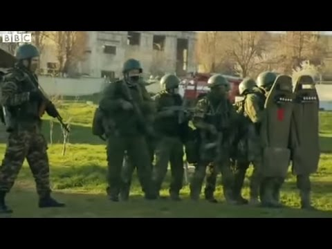 Russian troops storm Ukraine airbase in Crimea. BBC News Video