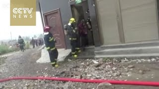 Firefighters save woman trapped in burning factory