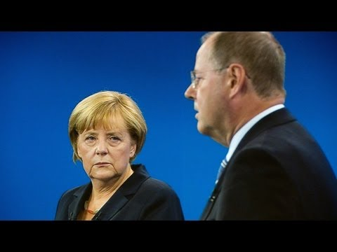 Angela Merkel defends Greek austerity measures in leadership debate - video