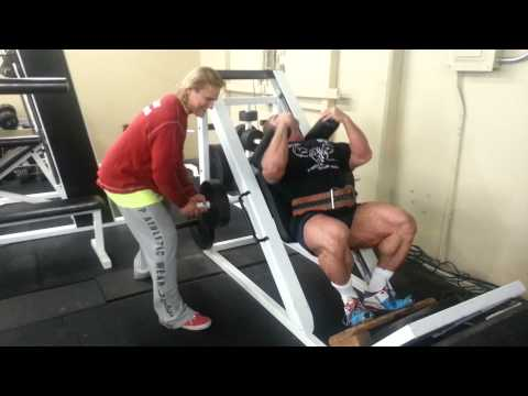 Tom Platz coaching me on hack squats with isotension
