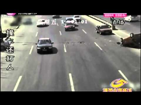 Man Punches Other After Car Accident