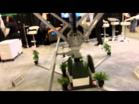 One Robot adjusts a field of Photo-Voltaic panels. By QBotix   Intersolar 2014