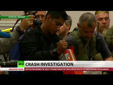 Eastern Ukrainian rebel leaders Monday evening turned over to international investigators the black boxes belonging to downed Malaysian Airlines flight MH17. The move came shortly after the bodies of the victims were handed over and placed onto a train that will travel to the Ukrainian city of Kharkiv. A reported 298 individuals were on board the aircraft when it was reportedly shot down Thursday over the Donetsk region of eastern Ukraine. After reaching Kharkiv, the victims\' remains will be transported to the Netherlands and other countries. RT\'s Roman Kosarev reports from the Donetsk region with more details.  Find RT America in your area: http://rt.com/where-to-watch/ Or watch us online: http://rt.com/on-air/rt-america-air/  Like us on Facebook http://www.facebook.com/RTAmerica Follow us on Twitter http://twitter.com/RT_America