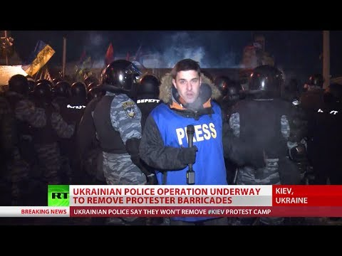 Breaking Barricades: Ukraine cops clash with protesters in attempt to clear roads