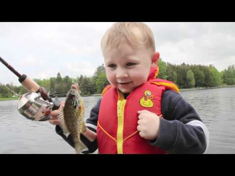 Funny Boy Fishing - Catches His First FISH!, Boy reacts to catching his first fish with his Dad