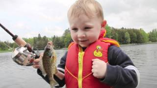 Cute Boy Catches His First Fish