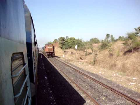 Indian Railways..Train with hybrid rakes crosses Mandovi express on Konkan Railway