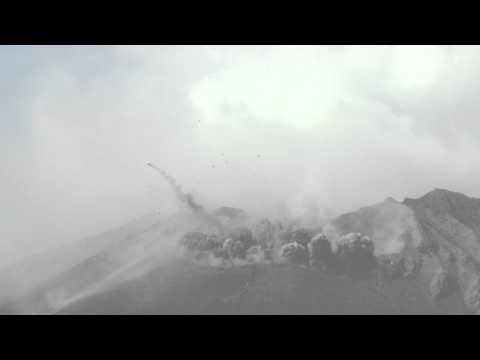 Shock Wave From Explosive Volcanic Eruption Slow Mo With Car Sized Flying Bomb