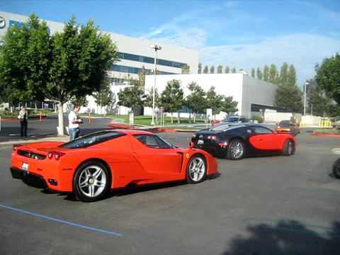 orange ferrari enzo and orange black bugatti veyron leaving youtube. Black Bedroom Furniture Sets. Home Design Ideas