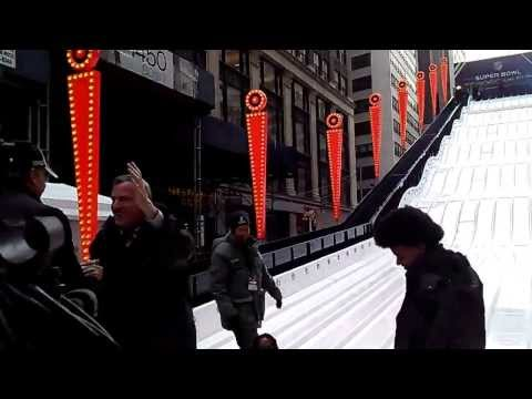 Mayor Bill de Blasio and family go down the Super Bowl slide at Times Square