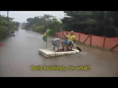Brazilian makes funny protest against the World Cup in Brazil, during a flood.