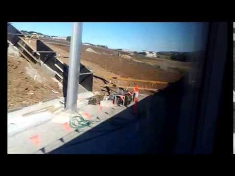 Passing by NSW TrainLink Shell Cove railway station under construction - 5/7/2014