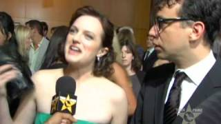 Elisabeth Moss & Fred Armisen Reveal Chocolate Obsession At 'Mad Men' Premiere view on youtube.com tube online.