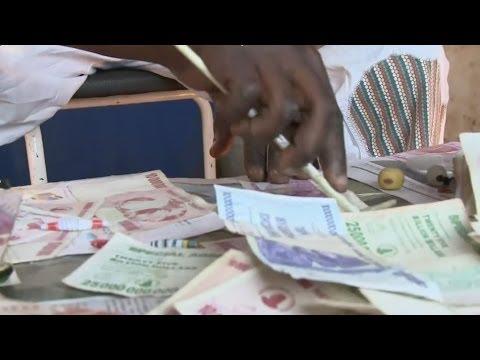 ZIMBABWE'S DOLLARS AS FASHION ITEMS - BBC NEWS image
