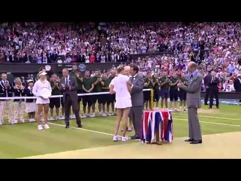 Petra Kvitova receives the Wimbledon trophy - Wimbledon 2014