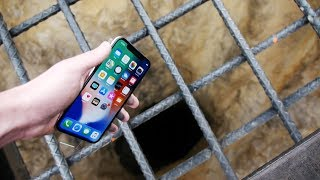 Dropping an iPhone X Down 4000 FT Deep Hole! - What's In There?
