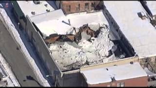 AP - Raw: Heavy Snow Causes Roof to Collapse
