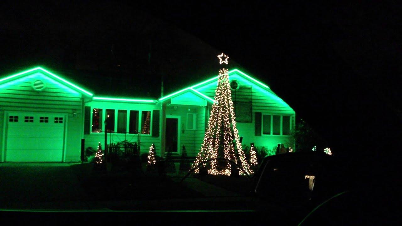 Crazy christmas lights on house move to music youtube for Christmas house music