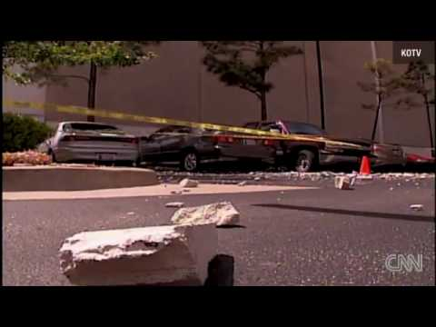 A car backed up through a wall in a Tulsa, Oklahoma, parking garage..flv
