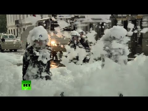 Thumbnail of video  Firemen soak cops in foam protesting cuts in Brussels