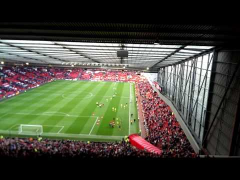 Manchester United and Ryan Giggs leaving the pitch of Old Trafford