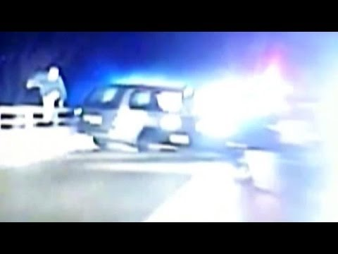 Cop Chases Suspect Over Bridge