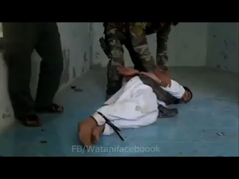 Torture on Tape: Disturbing Video Shows U.S. Special Forces Observing Brutal Afghan Interrogation