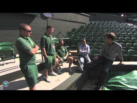 Champion Andy Murray chats with the Wimbledon groundstaff