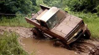 MUD TRUCKS HUGE CHEVY 4X4 On TRACTOR TIRES GETS STUCK DEEP
