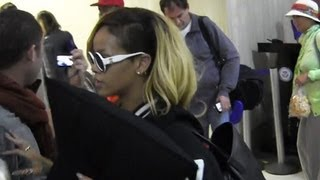 Rihanna Walks Through LAX As Fans Speak Out About Chris Brown