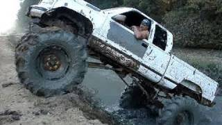 MUD TRUCK CHEVY SILVERADO 4x4 On TRACTOR TIRES CLIMBS
