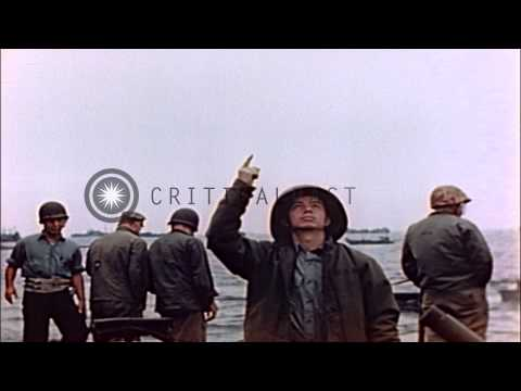 Wounded US Marines on litters are lowered to pontoon barge for transfer to Amphib...HD Stock Footage