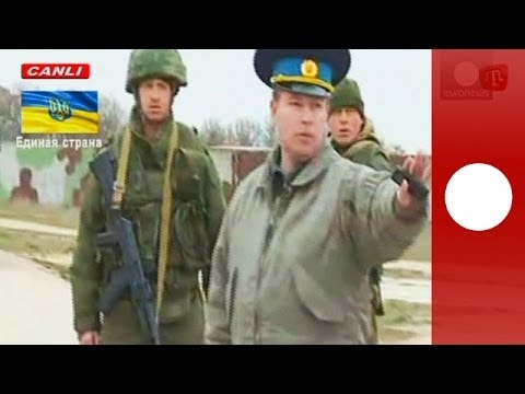 Video: Russian troops fire warning shots as Ukrainian military march towards Crimea air base