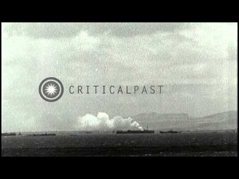Smoke columns rise from USS Minneapolis under bomb attack near Saipan, Mariana Is...HD Stock Footage