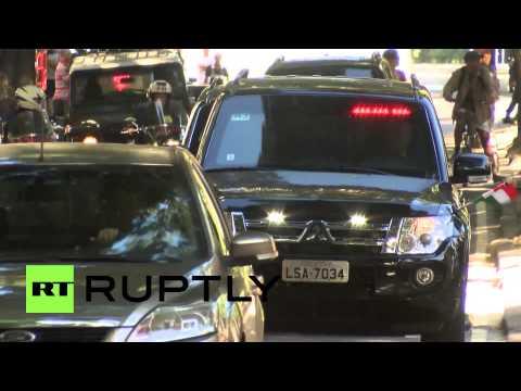 Brazil: Putin and Merkel head to World Cup match