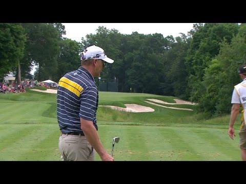 Tom Gillis' tee shot get lucky bounce at John Deere