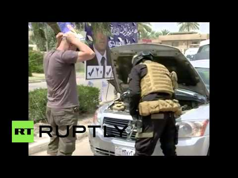 Iraq: Battle-ready volunteers flood Baghdad military base