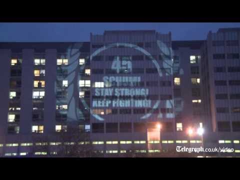Fans project tribute to Michael Schumacher on side of hospital building