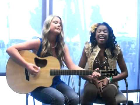 "Savannah Outen and Coco Jones singing, ""Who Says"" by Selena Gomez"
