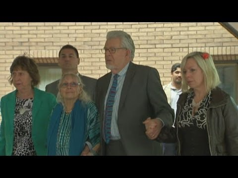 Rolf Harris walks slowly out of court after being found guilty of indecent assaults