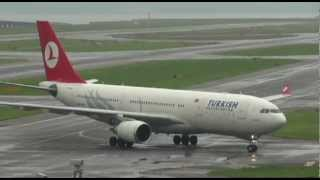 Turkish Airlines A330-200 landing at Kansai International Airport in light drizzle view on youtube.com tube online.