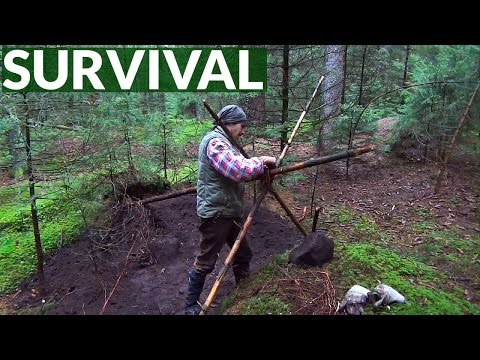 Survival Skills: Building an A-Frame Shelter and making fire on a rainy day in the forest
