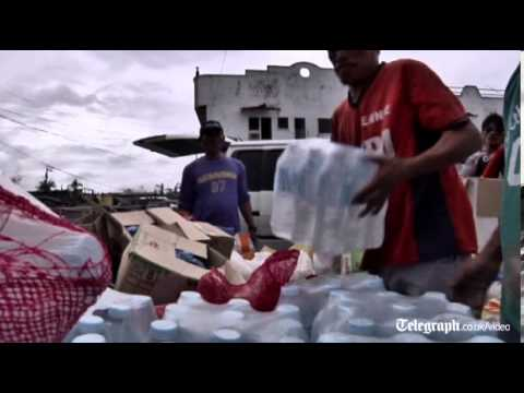 Typhoon Haiyan: aid begins to trickle into hard-hit areas of the Philippines