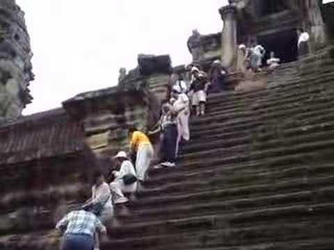 Cambodia - tourists climbing down Angkor Wat