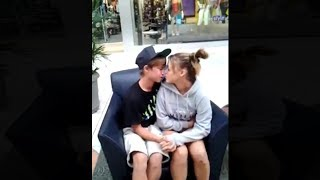 kids have an awkward kiss in public..